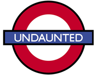 """A graphic of a red circle with a blue bar across it; inside the blue bar is the word """"undaunted."""""""