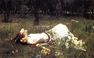A painting of the character Ophelia form William Shakespeare's Hamlet. She is a young woman lying in a field with a sad look on her face.