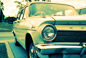 A photograph of an old station wagon in a driveway