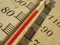 A photograph of thermometer mercury heading above 100 degrees on the scale