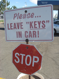 "A sign in a parking lot that reads; ""Please leave ""keys"" in car!"" There are quotation marks around the word keys which is an odd use of quotation marks."