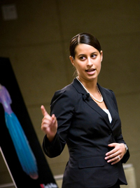 A photograph of a female attorney presenting an argument.