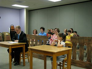 A photograph of a children's jury in a courtroom