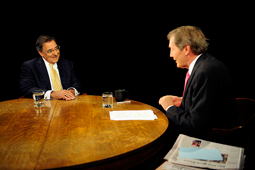 A photograph of talk show host Charlie Rose speaking with Defense Secretary Leon Panetta.