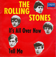 "A photograph of the Rolling Stones record sleeve ""It's All Over Now and Tell Me"" It has cut outs of the band's faces set around the words"