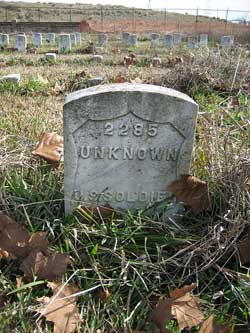"Image of a Cementery headstone with an inscription that reads ""Unknown"""