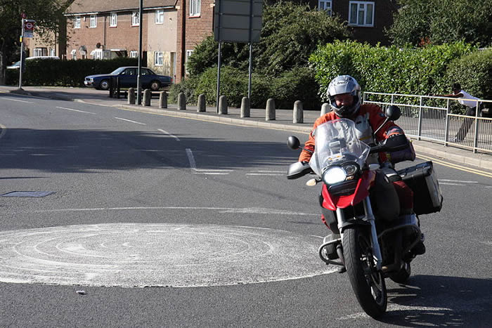 Image of a motorcycle driving away.