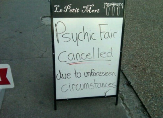 An ironic image of a chalkboard that reads 'Psychic fair cancelled due to unforeseen circumstances'