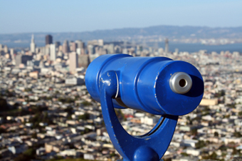 City skyline from above with telescope in foreground