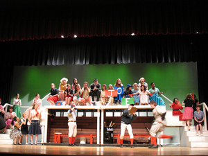 A photograph of a school play being performed on a stage.