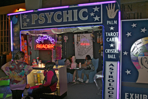 A photograph of the outside of a psychic reader's booth.