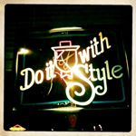 """= A photograph of a sign reading: """"Do it With Style"""""""