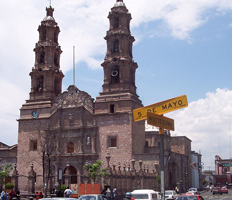 A photograph of the Cathedral Aguascalientes in Mexico, a typical Spanish colonial cathedral with two tall spires