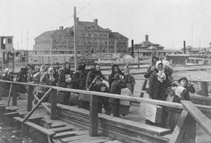 A photograph of immigrants landing at Ellis Island in the early 1900's.