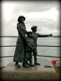 A statue of an Irish immigrant mother and her two boys about to board a ship that will take them to the US.