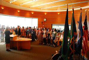 A photograph of people at a naturalization ceremony becoming U.S. citizens