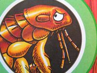 A cartoon of a huge, angry-looking flea