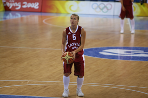 A member of the Latvian Olympic team gets ready to throw in a basketball game