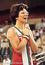 A photo from a 1978 Tennis match showing Billie Jean King. She looks like she may be about to speak, or she's waiting for an announcement or result.