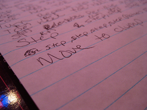 """A photograph of words handwritten on a lined page. The most visible words say """"move to the clump."""""""