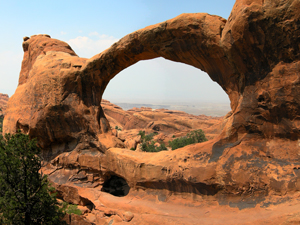 "A photograph of the ""Double O"" rock arch in the Utah desert"