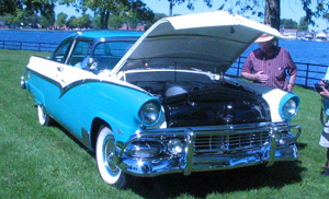A photograph of a 1955 Ford Fairlane at an auto show