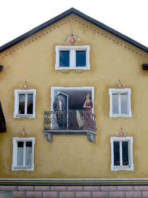 If you saw this house in Switzerland, you might think you were seeing a couple standing on a balcony, but you'd soon realize that the couple and the balcony are painted onto the side of the house. This is an optical illusion.
