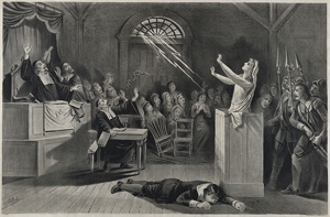 Picture shows a young woman in Salem, MA, on trial for being a witch.