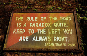 """Road sign that says: """"The rule of the road is a paradox quite, keep to the left you are always right."""""""