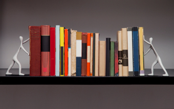 A row of books between bookends that look like people