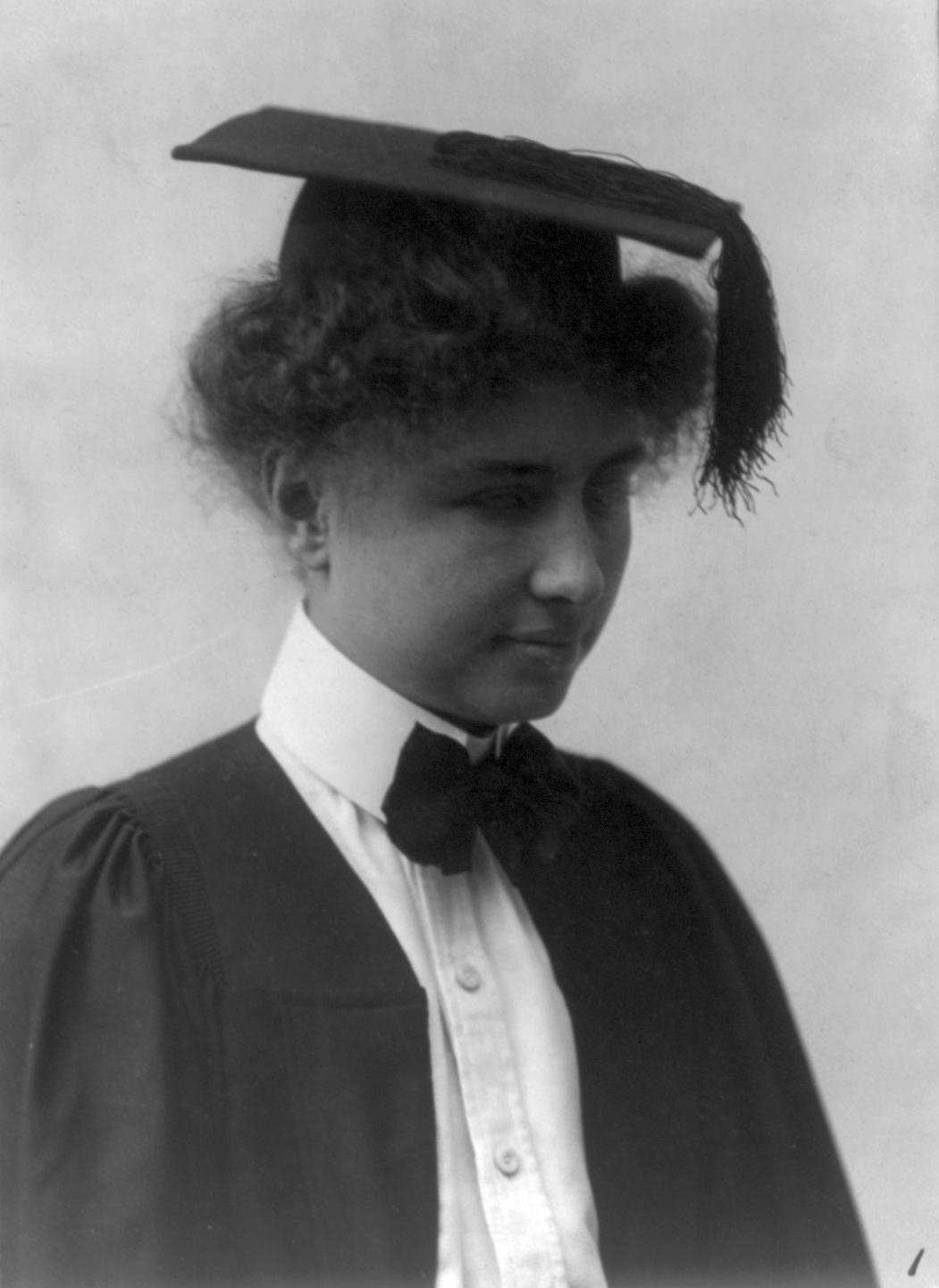 Photograph of Helen Keller with a mortarboard on her head