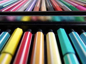 A photograph of a colored pen and pencil set