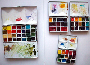 A photograph of three painter's palettes