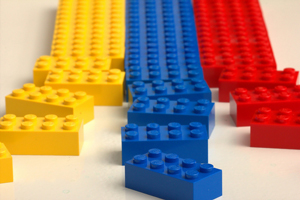 A photograph of a series of Lego blocks line up in rows. The ones closest to the camera are disordered