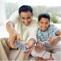 image of a man and boy playing video games