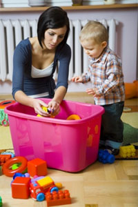 Woman with small child and a bucket of toys
