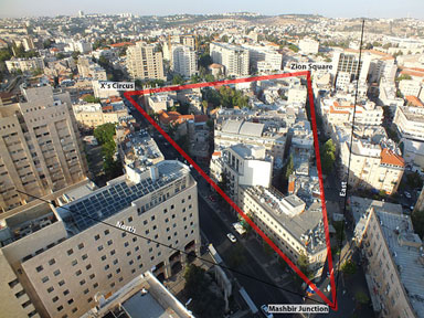 Ariel view of Jerusalem with streets intersecting in a triangle.