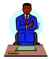 principal standing behind desk