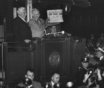 President Truman holding a copy of the newspaper with a false headline