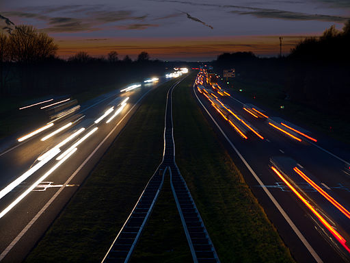 Time-elapsed photo of cars on a highway