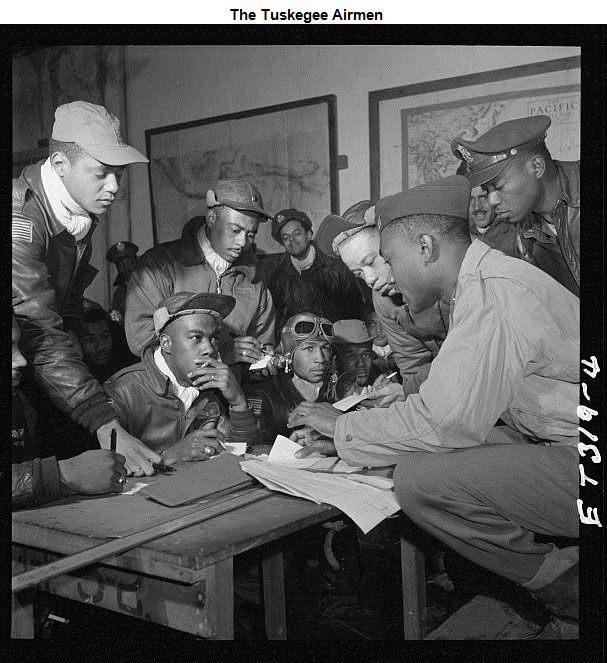 Image of Tuskegee Airmen studying a map