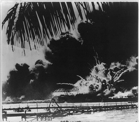 Image of a bridge and naval ship being bombed