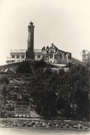 Image of Alcatraz Island with a building and watchtower on top