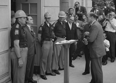 Photograph of Alabama Governor George Wallace confronting the Attorney General of Alabama at the doors of the University of Alabama
