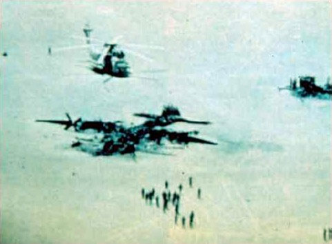 Image of a wrecked airplane and two downed helicopters