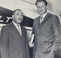 Image of Martin Luther King and Billy Graham standing in front of an airplane