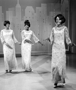 Image of musical groups, The Supremes. singing (from left to right, Florence Ballard, Mary Wilson, and Diana Ross)